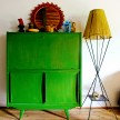 This bureau was painted a vivid green to match the surroundings.