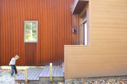 The exterior--a striking combination of rust-colored corrugated metal and wood.