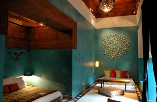 Turquoise walls and elaborately carved ceilings in Room 10.