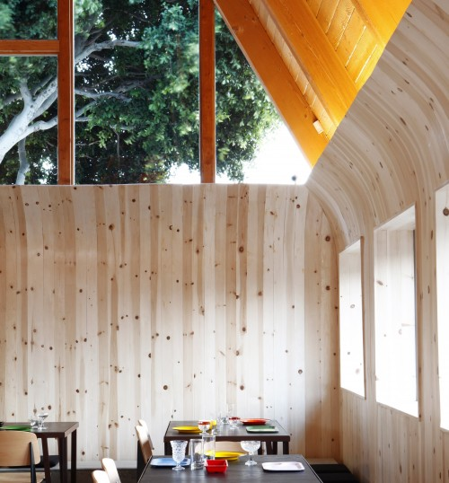 Knotty pine walls and picture windows at A-Frame.