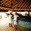 Waiters at the Uxua beach bar, where the bar was fashioned out of an old fishing boat.