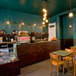 Simon Says coffee bar, with a set of recently rehabbed rooms above.