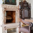 Intricate carved wood chair and fireplace mantel