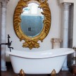 Tub with huge gilded mirror above