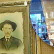 Gilded framed portrait and two-tone mirror at Berkeley Springs Antique Mall.