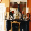 Vignette of candlesticks and glass domes (Photos Matthew Hranek)