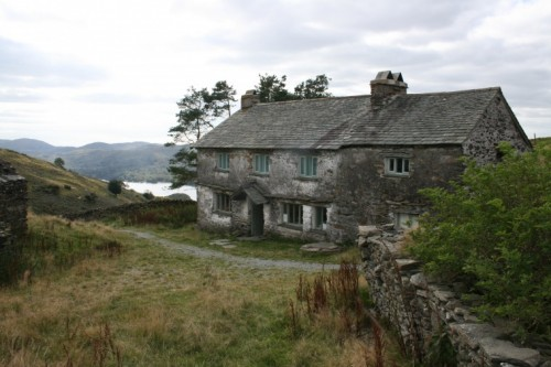 The stone farmhouse has views over Coniston Water in the Lake District.