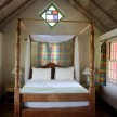 Four-poster bed and plaid curtains - garden view cottage.