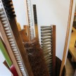 Old, refurbished brushes for sale at the shop in Oakley.