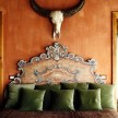 Ornate headboard in the Sassi rooms