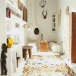 This room is a great example of how Graham and Emma mix traditional Moroccan pieces with pops of modern artwork and decor.