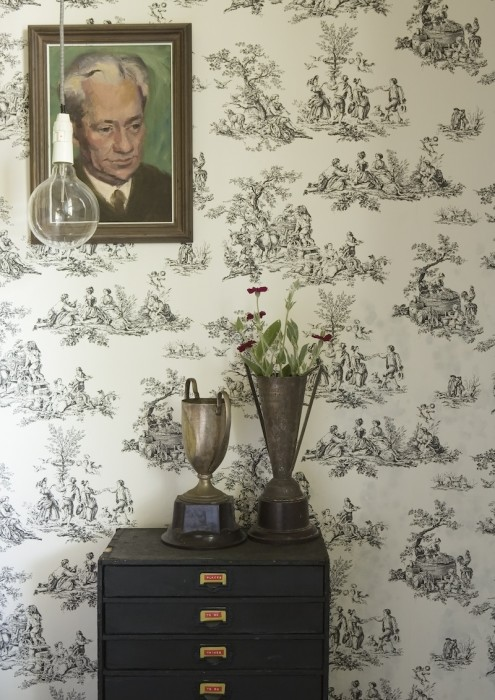 Antique trophies are stuffed with fresh flowers.