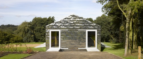 Silver-tiles reflect the barn-like building's setting, which is found in a nature reserve in Suffolk.