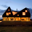 All lit up, you can really appreciate how the atypically-shaped house was designed with view in mind.