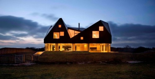 The majestic Dune House at dusk.