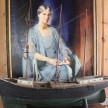A portrait of the original owner hangs above a model ship.