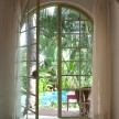 Each of the bedrooms has a set of beautiful French doors. Here, this room opens right into the lush pool area.