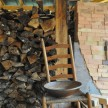 Wood to fire the kiln; bricks to close the door.