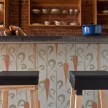 Wallpaper by Chicago wallpaper designer Casey Gunschel lines the kitchen island; stools crafted by MOCAD exhibit coordinator Zeb Smith.