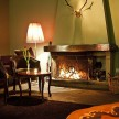 The cozy lounge area, where guests can hang out in front of the fireplace.