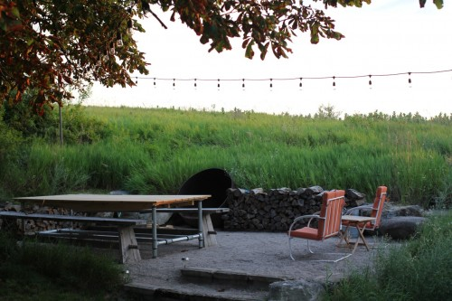 Outdoor table, fire pit and hammock -- all with views of the countryside.