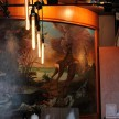 Joe Becker's mural, inspired by Baroque hunting paintings, adorns a wall in the lounge.