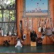 Kitchen utensils, dishware and appliances are all displayed on open shelving.