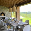 The portico is protected from the wind without sacrificing views. Fradiani surrounds the travertine-topped table (that he designed himself) with Vernor Panton chairs.