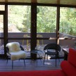 The best of many examples of indoor-outdoor living: When these glass doors open up entirely, it feels like you're hanging out in the trees.