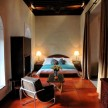Hand-sewn camel leather floors and a fireplace in Room 18.