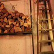 Wood stacked inside to feed the pizza oven