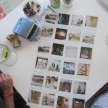 Polaroid photos from the trip, spread out on a table at Hotel Basico.