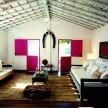 The spacious, vibrant living room of Seu Pedrinho overlooking the historical Quadrado.