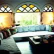 The comfy lounging area with view of quadrado on the mezzanine in Gulab Mahal casa.