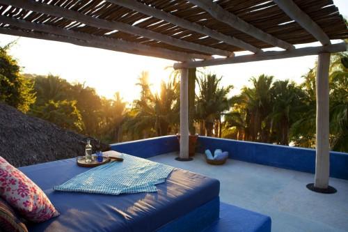 Jungle and ocean views from the rooftop terrace at Casa Ninamu.