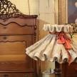 This frilly, parasol-style lampshade was easily a favorite. Bet the little girl who grew up with it in her room won a lot of pageants.