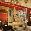 I'm not sure who puts together these displays but this sailboat on a toile-covered wingback like straight out of Anthropologie.