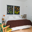 Botanical prints in the fourth-floor Gulbenkian apartment's bedroom