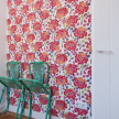 Bold wallpaper on a single wall in the fifth-floor Principe Real unit