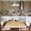 The minimal kitchen feels rustic and modern.