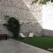 A peaceful garden that shows off those ancient stone walls.