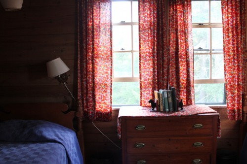 I the imperfections, from crooked lamp shades to mix and match patterns, and this sweet bedroom is the perfect example.