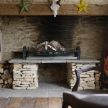 High-low contrast: sparkly antlers above the traditional, rustic hearth.